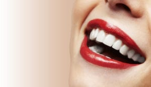 up close photo of laughing woman with beautiful smile