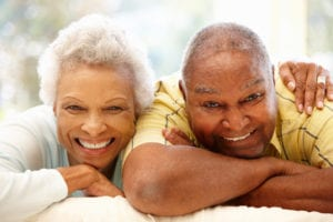 portrait of smiling elderly couple at home