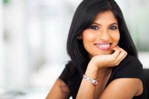 indian woman with white dental crowns