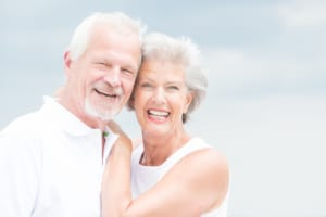 Smiling senior couple with dental implants