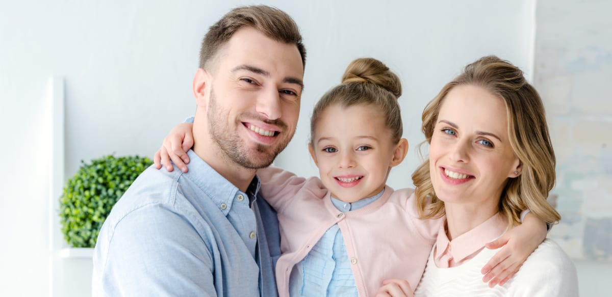 family smiling about general dentistry