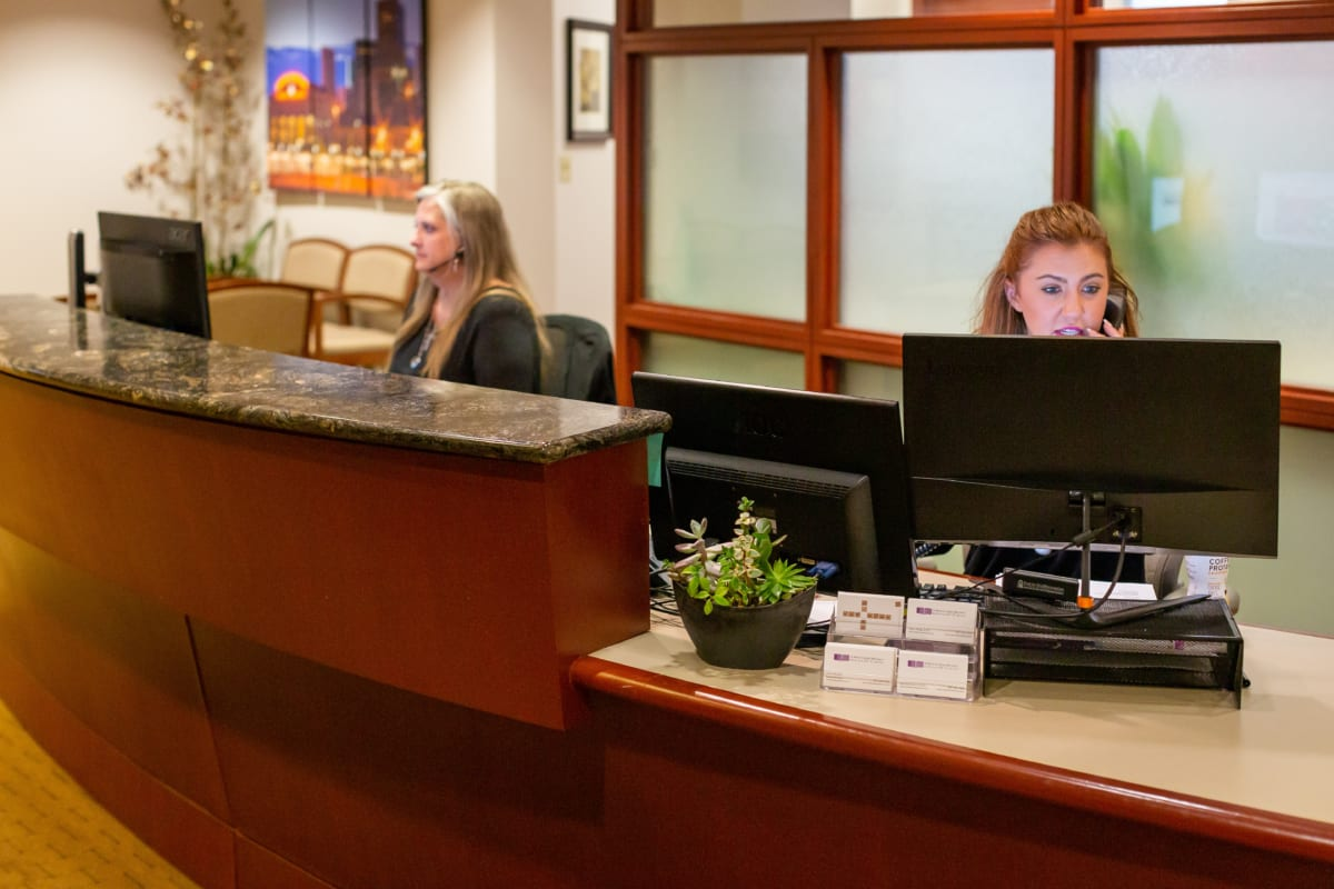 dental office front counter with two receptionists