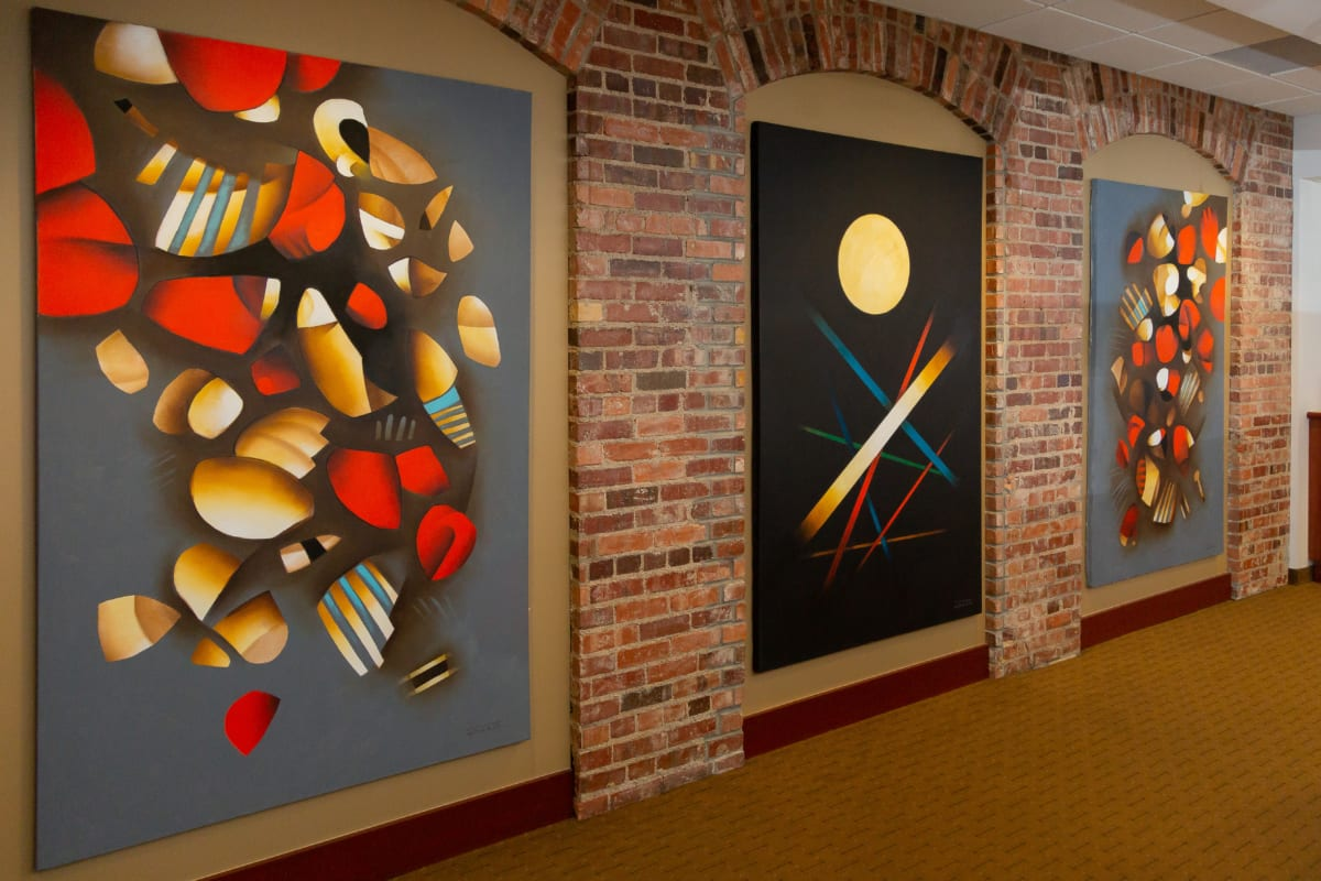 Three large modern paintings in office hall